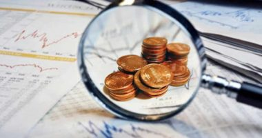 top penny stocks to watch this week magnifying glass pennies